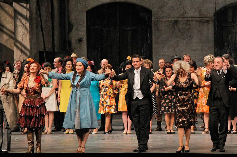 Louise Callinan, Genia Kuhmeier, Philippe Jordan, Anna Caterina Antonacci, and Philippe Faure bow onstage with cast.