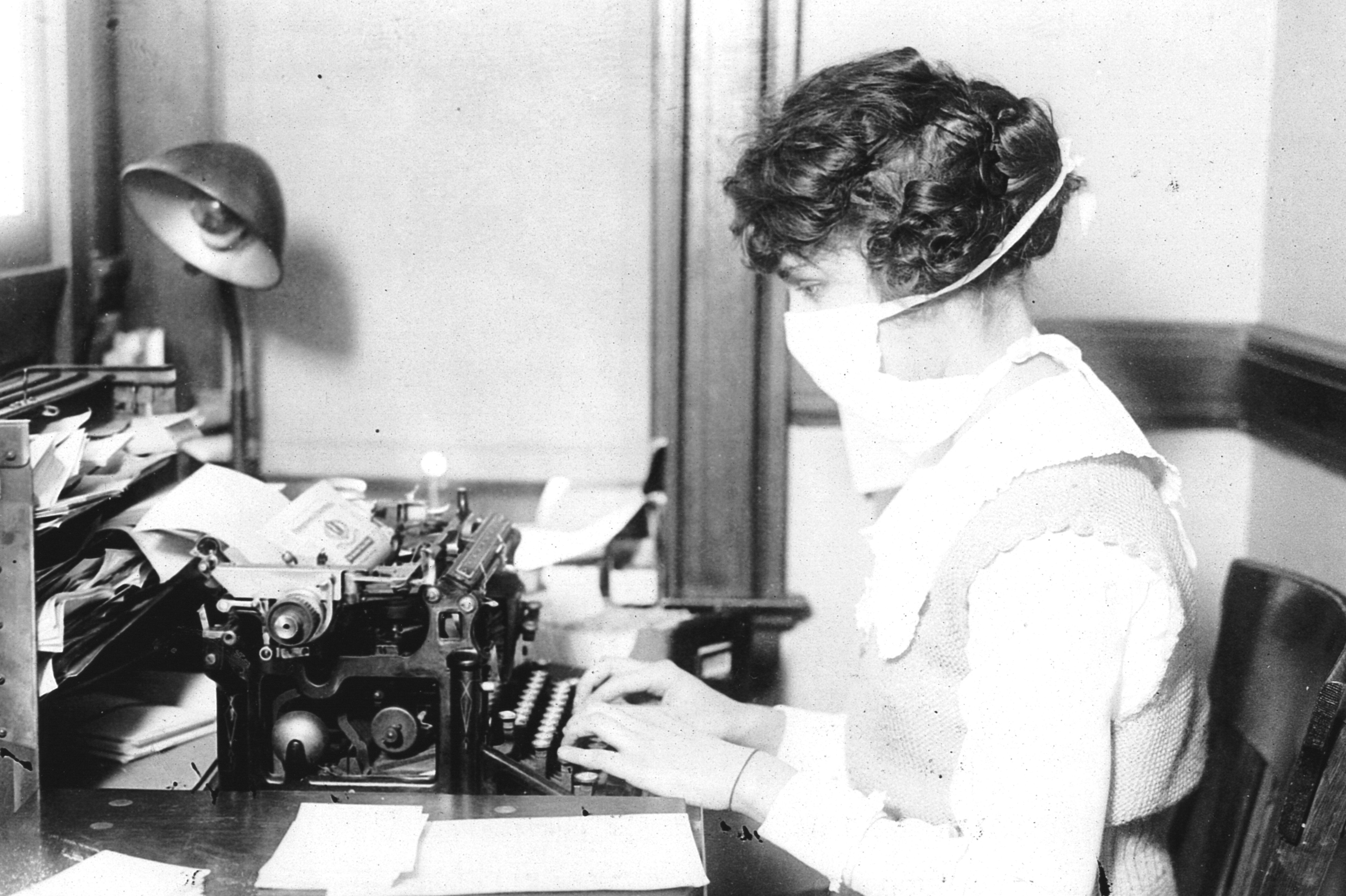 During the 1918 Spanish Flu Pandemic Typist wearing mask, New York City. (October 16, 1918)