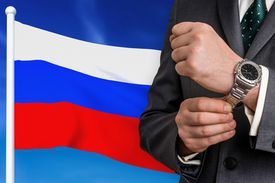 Business in Russia. Businessman on national flag background.