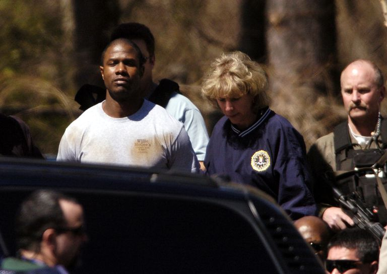 FBI agents escort murder suspect Brian Nichols from an FBI holding facility