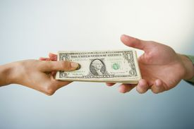 one person handing over money to another