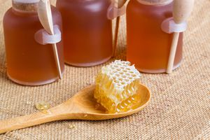 Honeycomb on wooden spoon