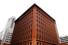 red masonry high rise with three distinct exterior design