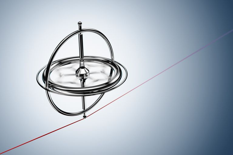 Spinning gyroscope, balancing on a red cable