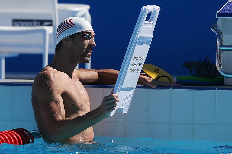 Micheal Phelps Holding a Sign