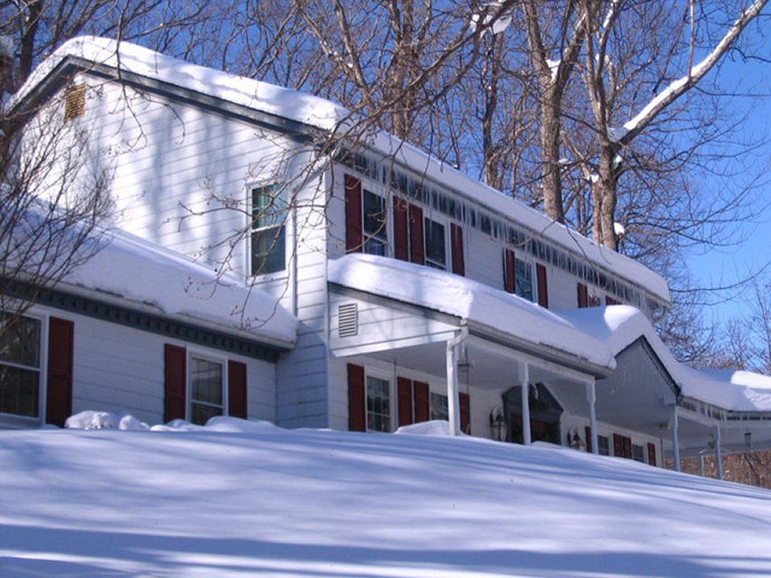 A homeowner's white colonial gets lost in the white snow
