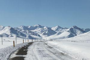 Endless mountain road through winter landscape