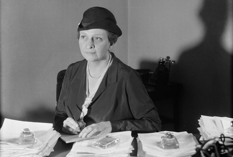 Photograph of Frances Perkins at her desk