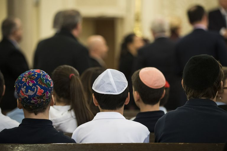 young people sitting in an Orthodox synagogue