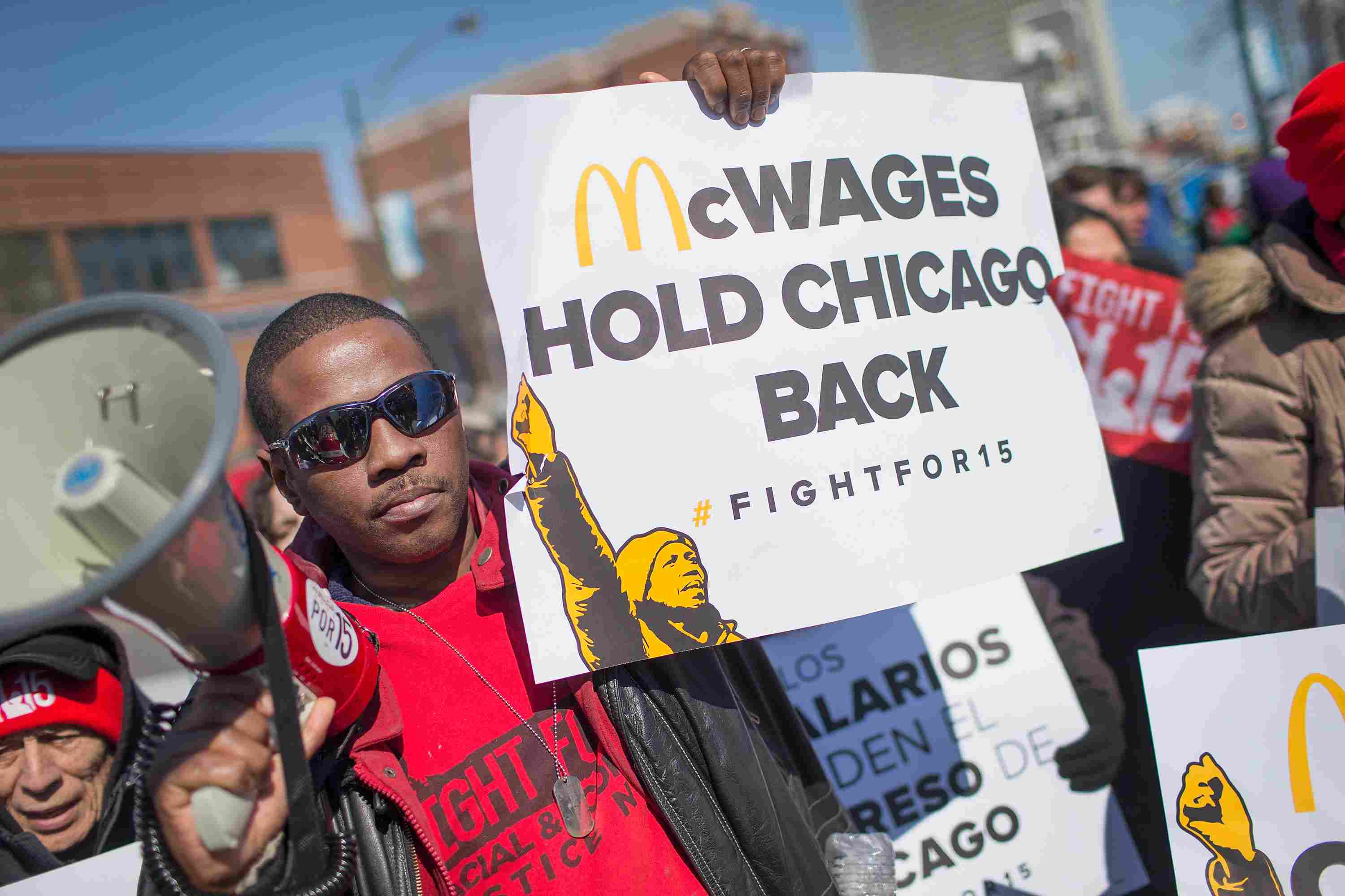 McDonald's workers strike for a living wage, symbolizing Marx and Engels' predictions for revolt in The Communist Manifesto.