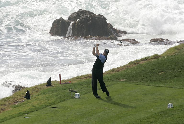 Phil Mickelson between tee markers at Pebble Beach