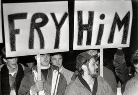 Protesters Carrying Signs