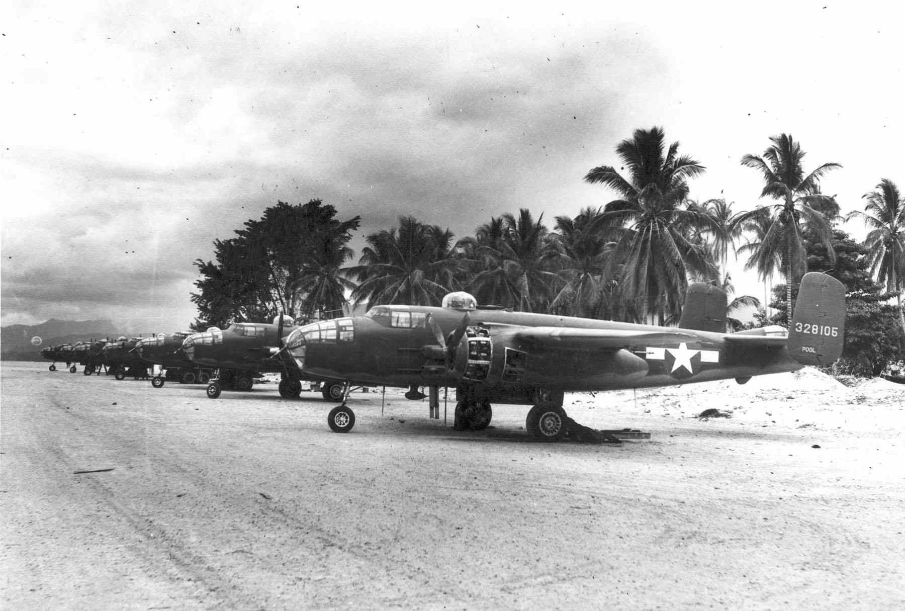 B-25 bombers lined up on a runway in the south Pacific.