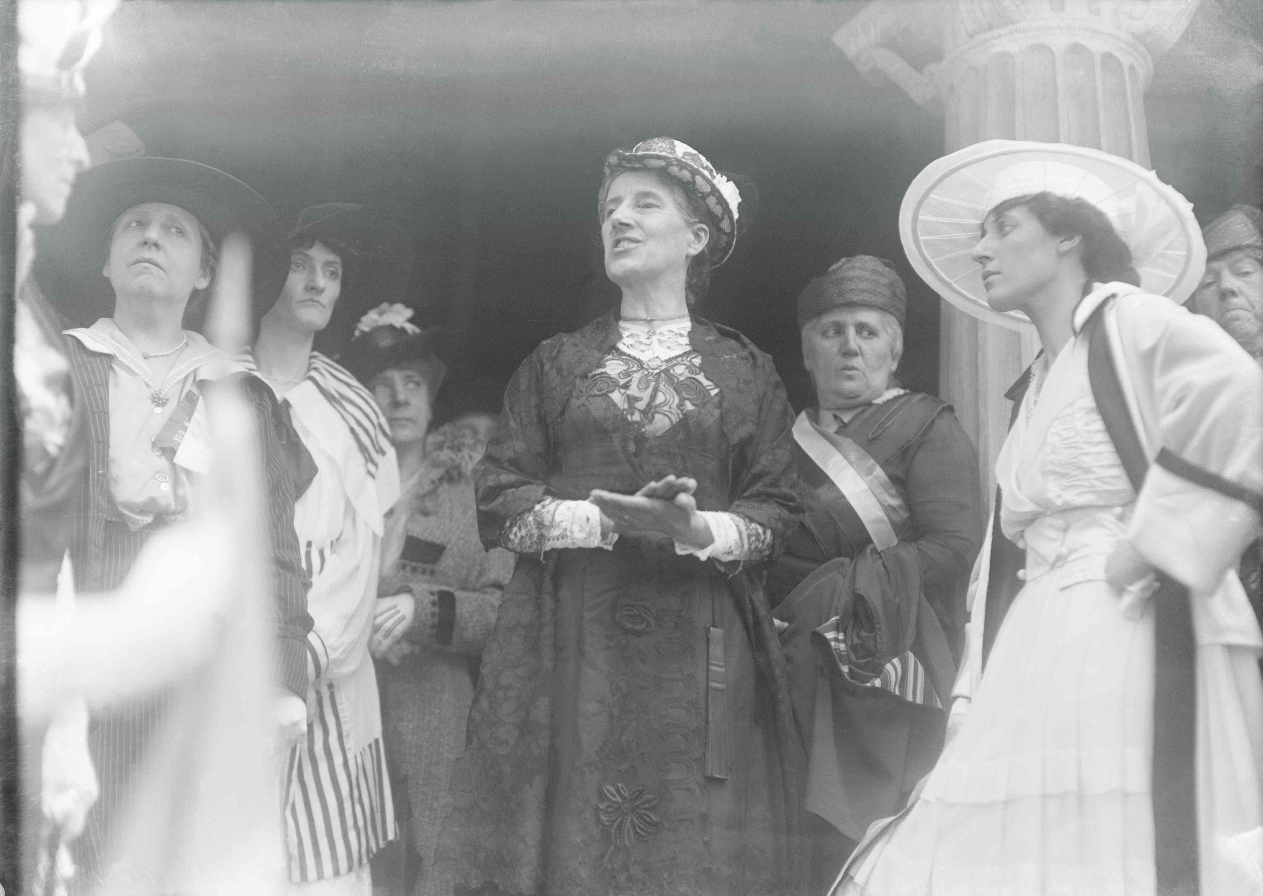 Gilman addresses a crowd of women