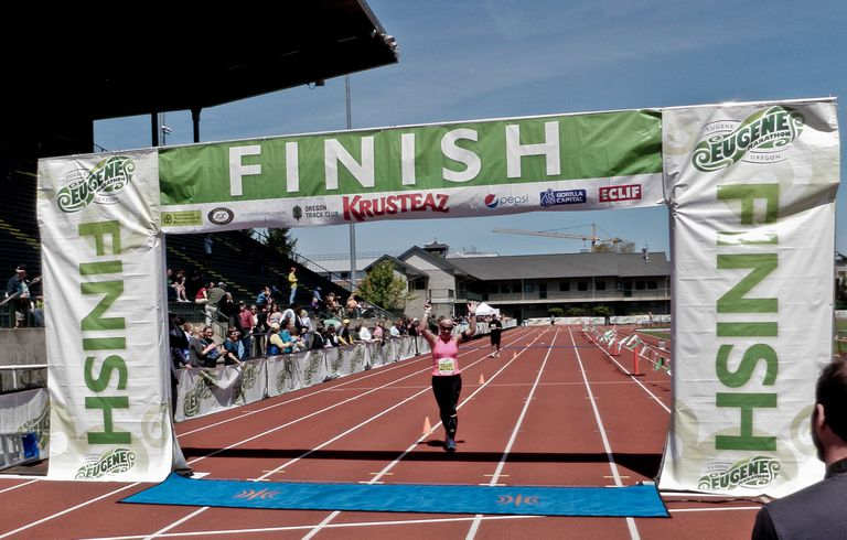 Woman crossing the finish line at a race.
