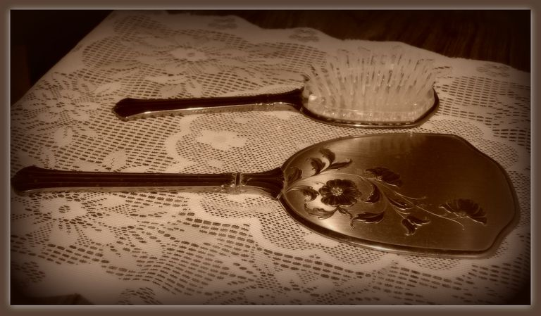 Antique silver brush and mirror