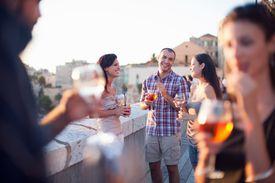Friends having drinks on a balcony