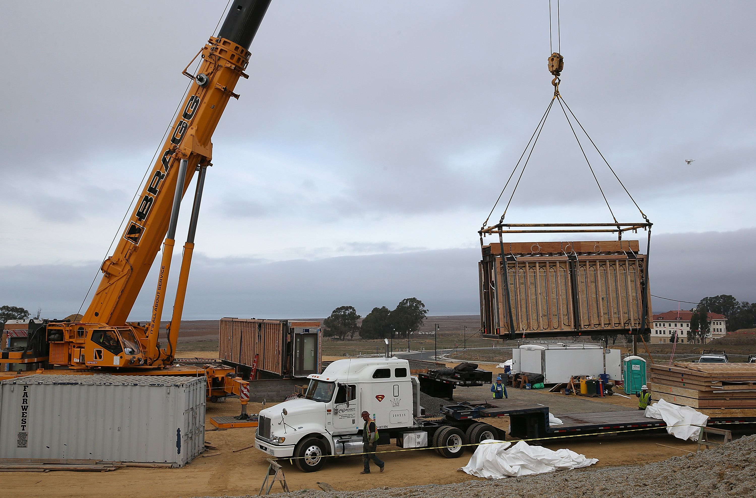 The Breezehouse being constructed. A crane lifts a section of a Blu Homes pre-fab modular home, 2014, California