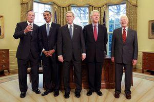 Presidents Bush Sr., Obama, Bush Jr., Clinton, and Carter in the Oval Office