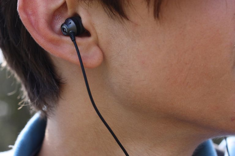 Bud earphone in someone's ear
