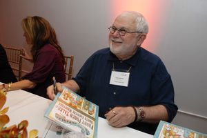 Children's author Tomie dePaola at a book signing event.