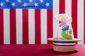 A straw hat in front of an american flag
