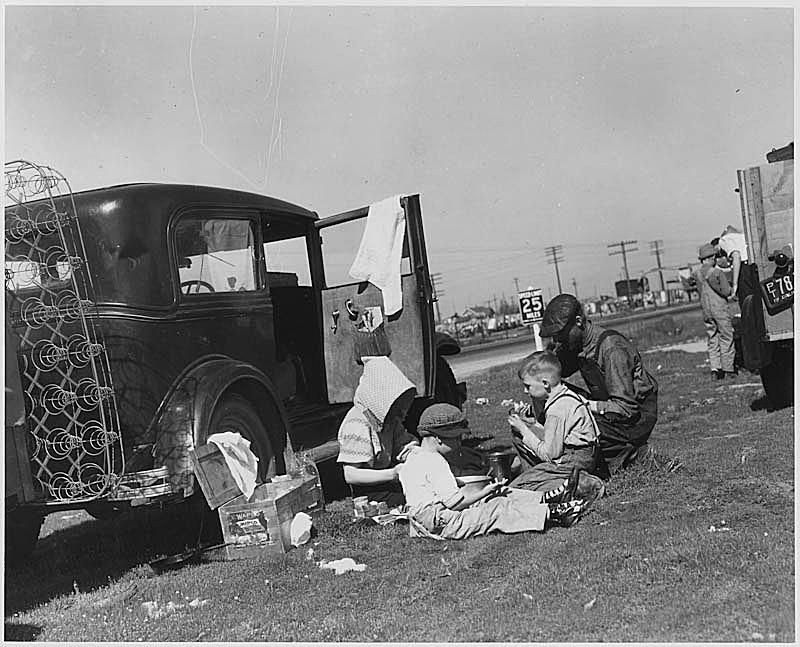 Migrants living out of their car during the Great Depression.