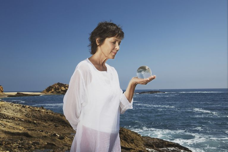 Woman holding an orb on the beach