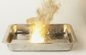 Metal tray with explosive thermite reaction occuring