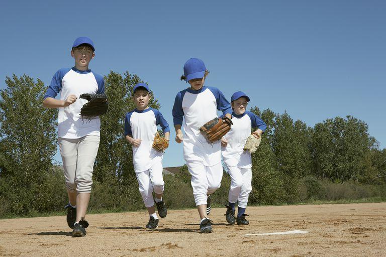 Boys running with baseball gloves
