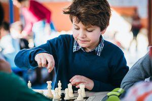 A boy playing chess