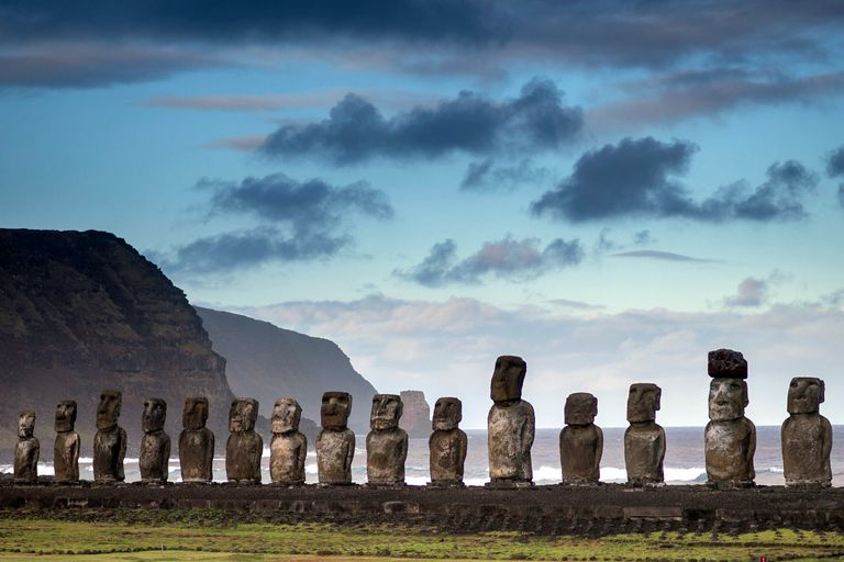 A row of moai sculptures against a cloudy Easter Island sky