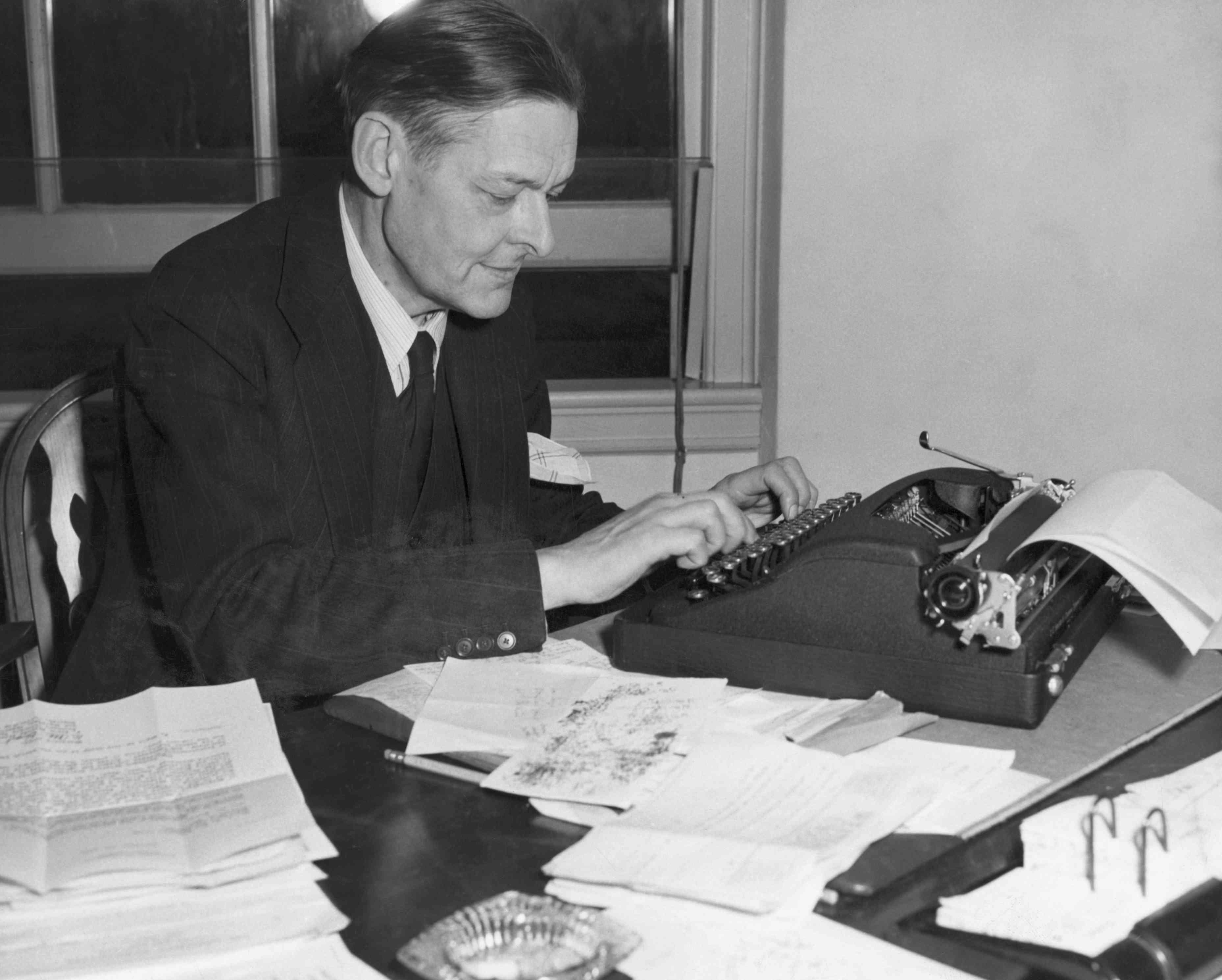T S Eliot At Desk Inspecting Manuscripts
