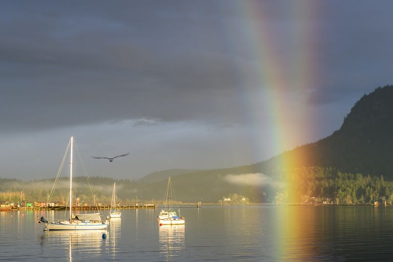 A rainbow over vessels in Cowichan Bay, British Columbia