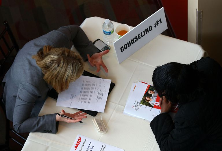 A career adviser assisting a client at a job fair