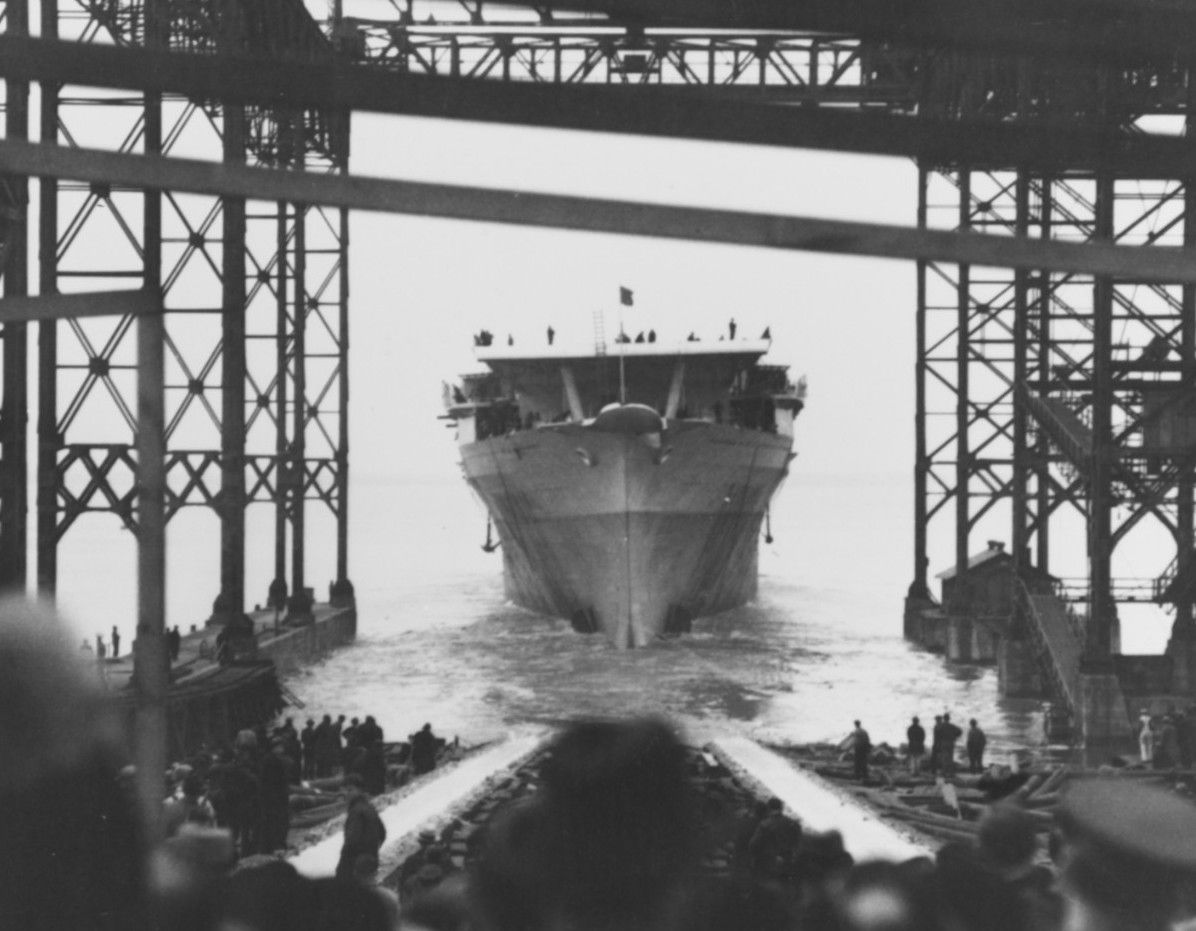 Hull of USS Ranger sliding down the ways into the war.