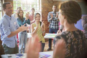 Group applauding inspiring speaker.