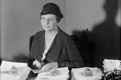 Photograph of Frances Perkins at her desk
