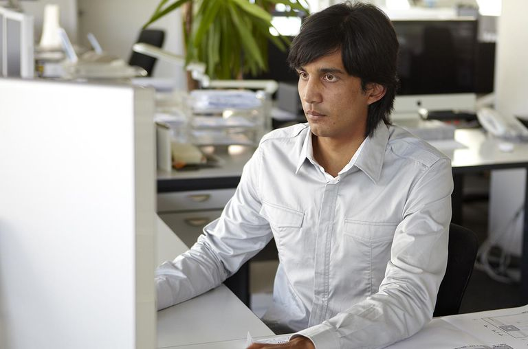 Man using computer in architects office