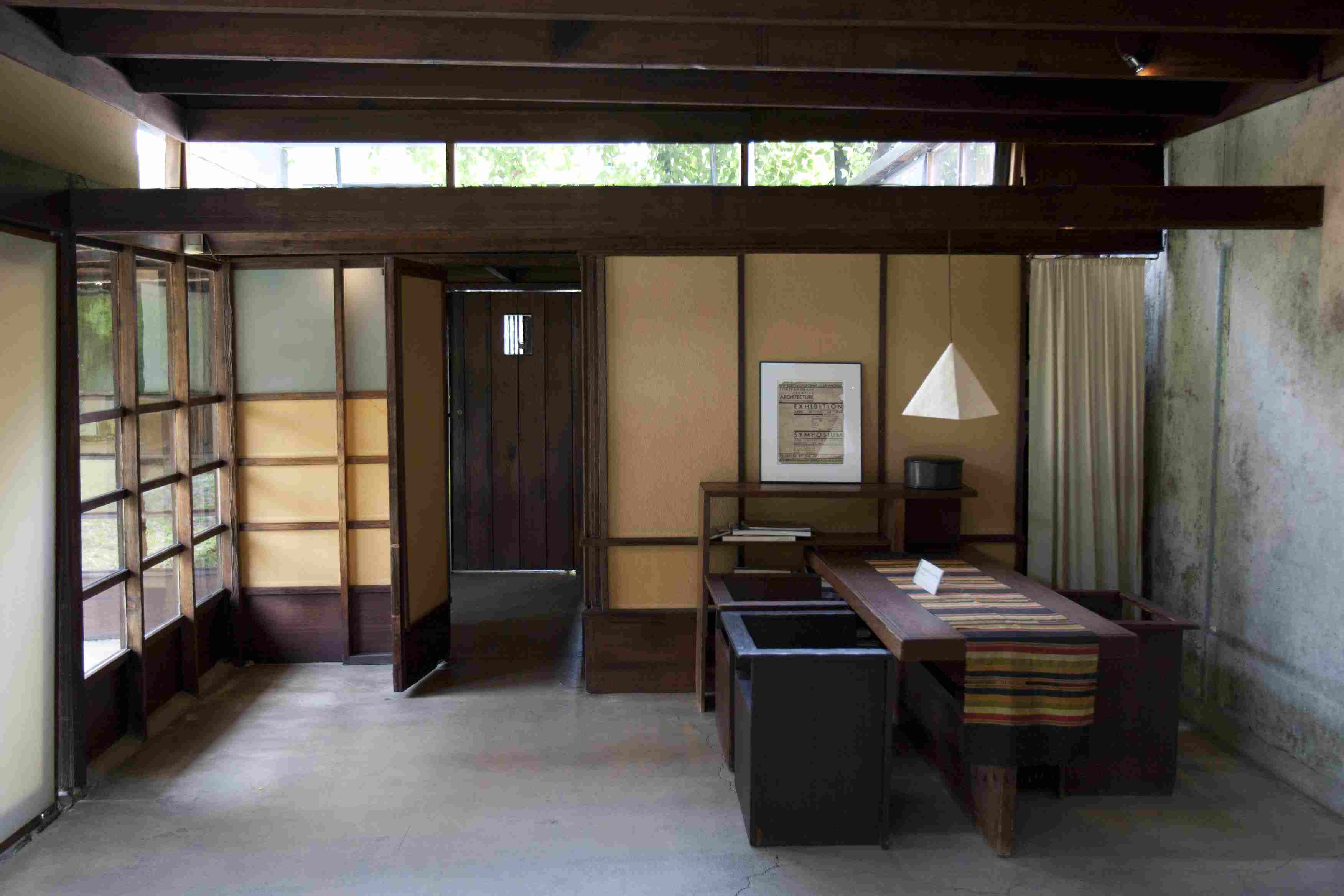 Wall of windows and clerestory windows light interior space at the 1922 Schindler House in Los Angeles, California