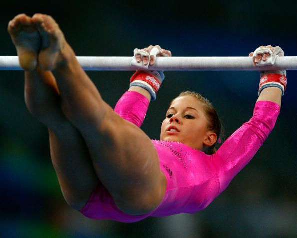 Gymnast Shawn Johnson (USA) on bars at podium training for the 2008 Olympics