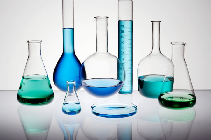 chemistry glassware containing colored liquids