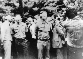 American hostages being paraded by their militant Iranian captors.