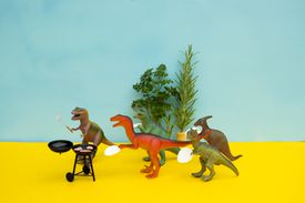 Fun Colorful Toy Dinosaurs Conceptual Scene - BBQ Meat Eaters