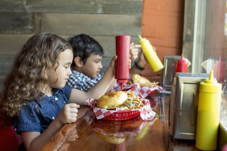 Children having burgers in restaurant