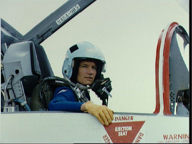 Sally Ride Preparing for Departure in T-38 - Prepares to Put On Face Mask