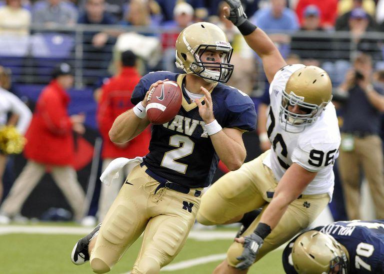 Navy quarterback Jarod Bryant (^2), from Hoover, Alabama, eludes Notre Dame defensive end Pat Kuntz