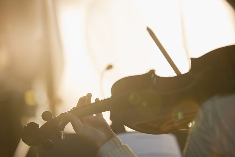 Close up of violinist playing the violin