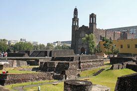 Tlatelolco's Templo Mayor and Santiago de Tlatelolco on sunny day.