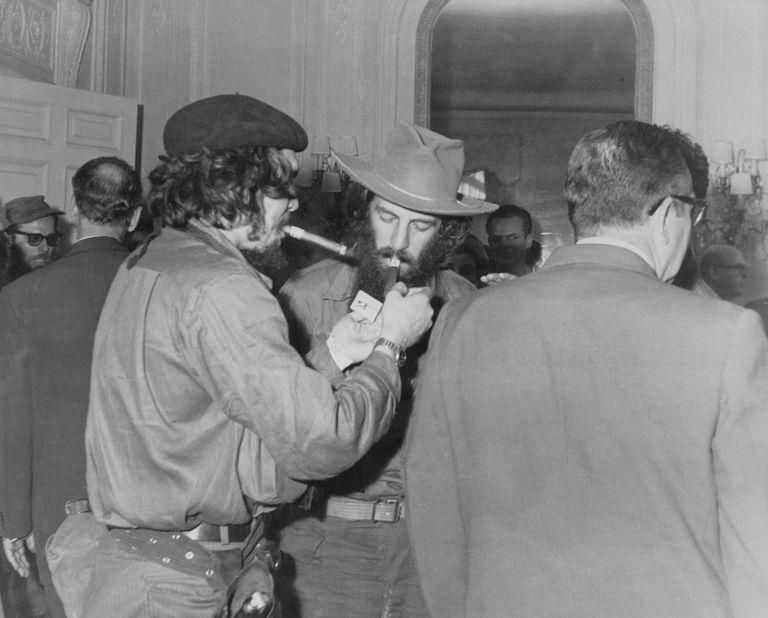 Che Guevara and Camilo Cienfuegos Lighting Cigars to Celebrate Victory